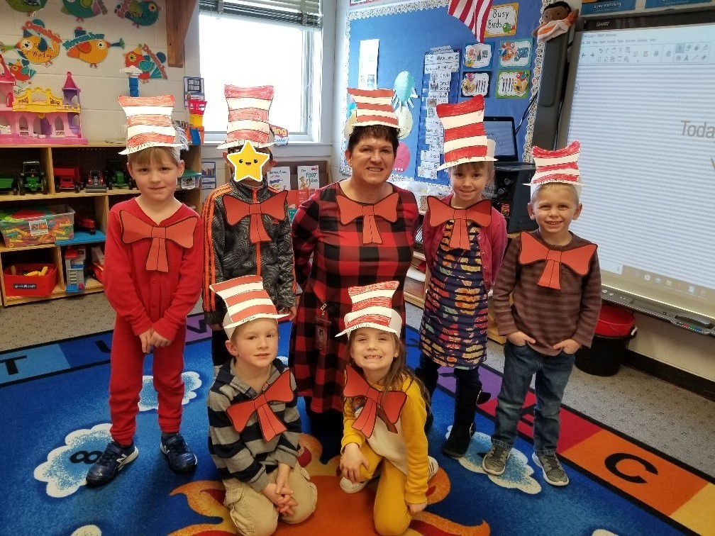 Students dressed up as the cat in the hat pose for a photo